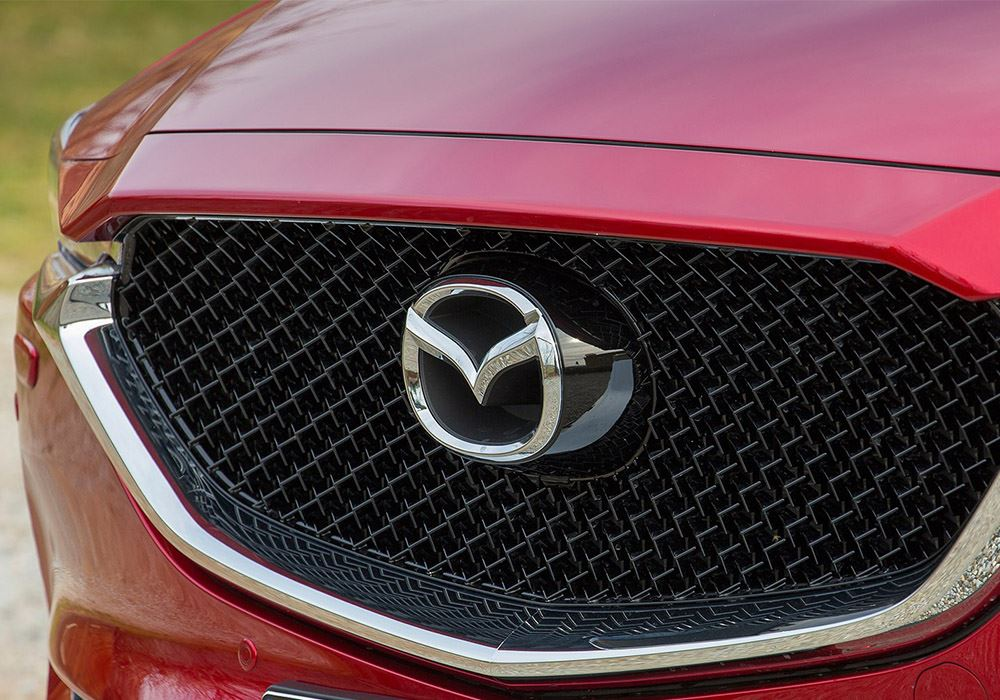 Front grille of car showing Mazda logo